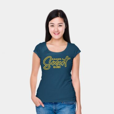 Woman with her hands in her pocket wearing raising a smart girl t-shirt