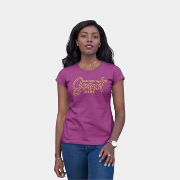 Woman with her hand on her leg wearing raising a smart girl t-shirt